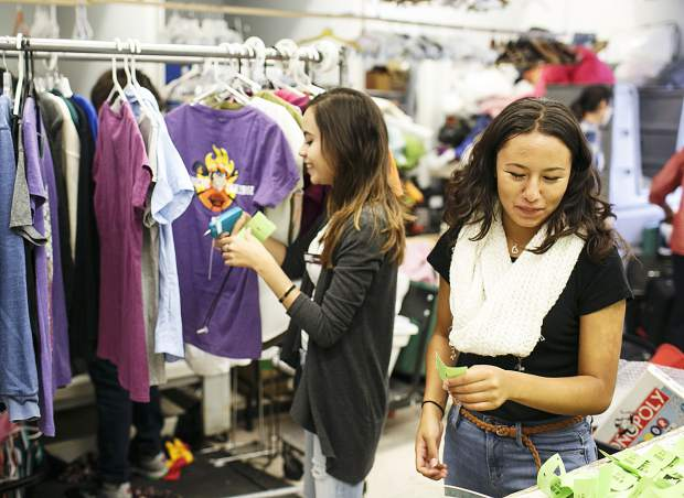 Ingrid Gaspar, right, interacts with other employees at the Family & Intercultural Resource Center thrift store during her work shift Thursday, Sept. 7, in Dillon.