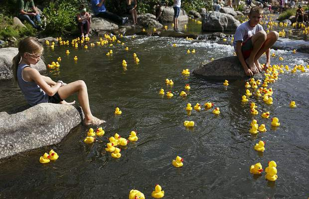Young spectators watches thousands of rubber ducks float down the Blue River Saturday, Sept. 2, in Breckenridge.