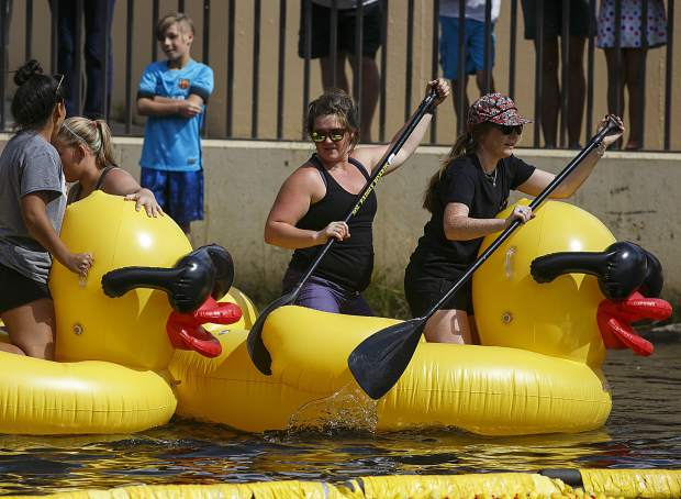 People float on large inflatable ducks on the Blue River Saturday, Sept. 2, in Breckenridge.