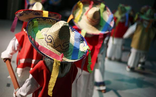 Students wear sombreros as part of the