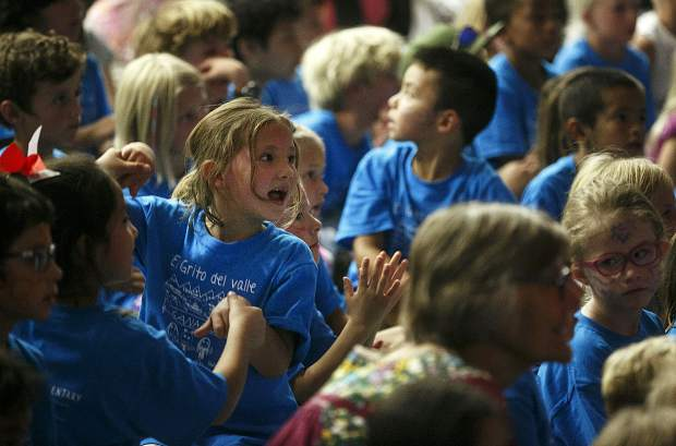 Dillon Valley Elementary first-grader Faith Cunningham sings along while watching a performance in the