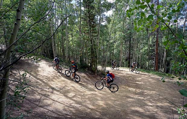 Racers ascend up a series of aspen-lined switchbacks during the Fall Classic mountain bike race in Breckenridge on Sept. 6.