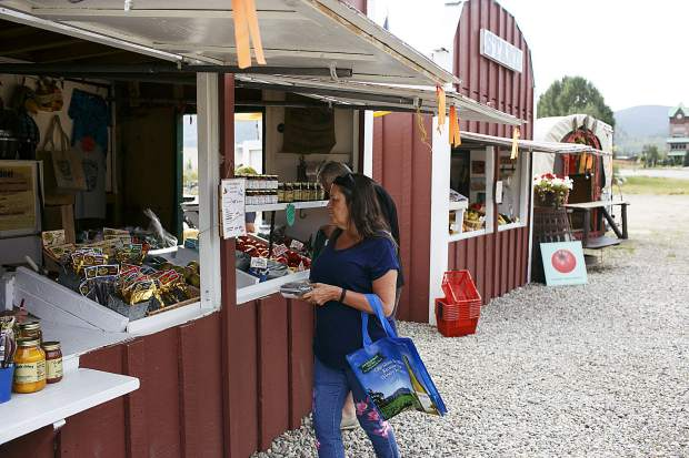 Costumers shop for produce at Uncle John's Farm Stand Saturday, Sept. 9, in Frisco.