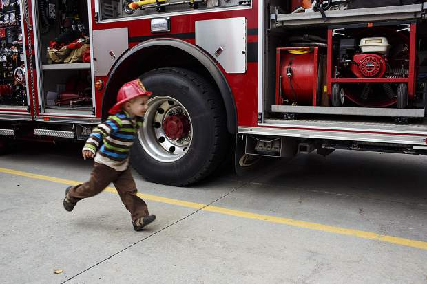 A young visitor runs around the fire truck during the Ice Cream Social Saturday, Sept. 30, at the station in Frisco.