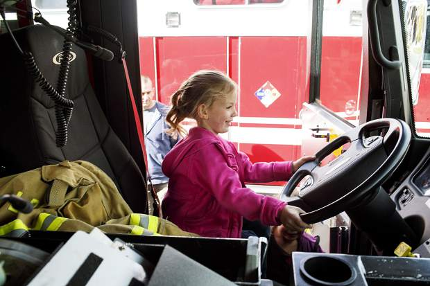Carina Basil, 5, of Silverthorne, explores the fire truck during the Ice Cream Social Saturday, Sept. 30, at the station in Frisco.