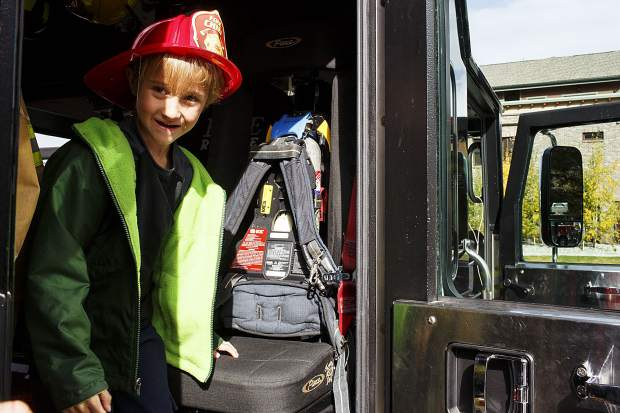 Cadence Ojala, 7, of Silverthorne, explores the fire truck during the Ice Cream Social Saturday, Sept. 30, at the station in Frisco.