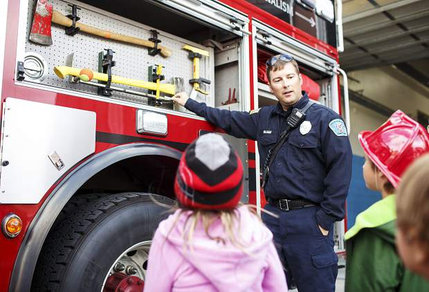 Lake Dillon Fire-Rescue firefighter Mike Williams educates children about tools used to fight fire during the Ice Cream Social Saturday, Sept. 30, at the station in Frisco.