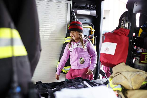 Aspen Ojala, 5, of Silverthorne, explores the fire truck during the Ice Cream Social Saturday, Sept. 30, at the station in Frisco.