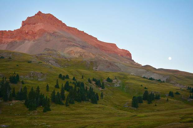 Uncompahgre Peak is Colorado's sixth highest 14,000 foot mountain. The valley floor below it made for a spectacular campsite, especially with the full moon rising overhead.