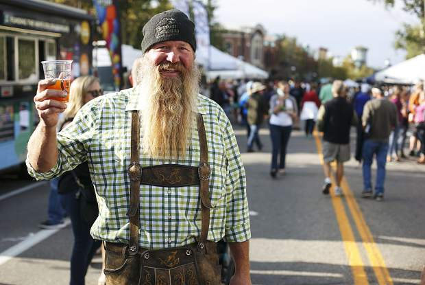 Eventgoers don costumes in Breckenridge Oktoberfest spirit, Friday, in Breckenridge.