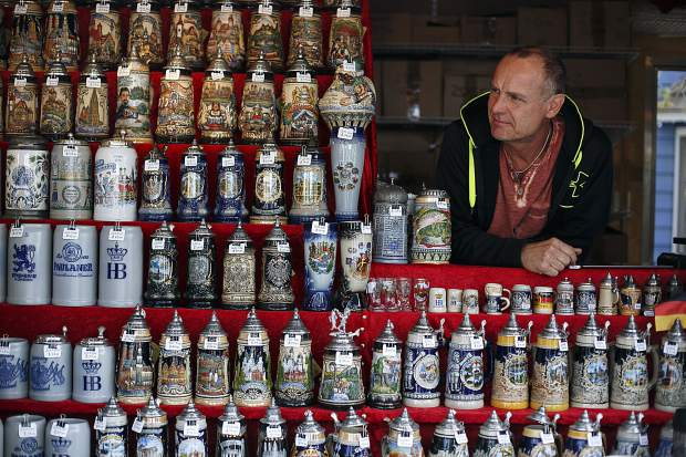 German Steins and Souvenirs owner Frieder Frotscher overlooks his sales booth during the Breckenridge Oktoberfest event Friday, in Breckenridge.