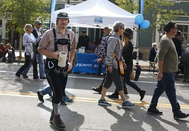 Eventgoers don costumes in Breckenridge Oktoberfest spirit Friday, in Breckenridge.