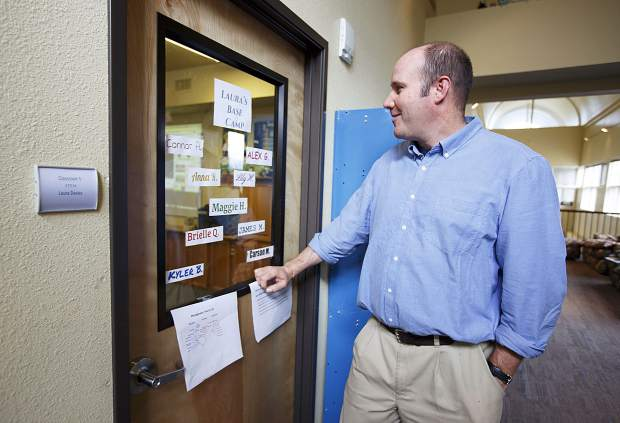 Travis Aldrich, The Peak School's new head of school, looks in on a classroom from the hallway on Wednesday, Sept. 13, in Frisco. The 41-year-old private education veteran eyes enrollment expansion for the independent program beyond its current 70 students.