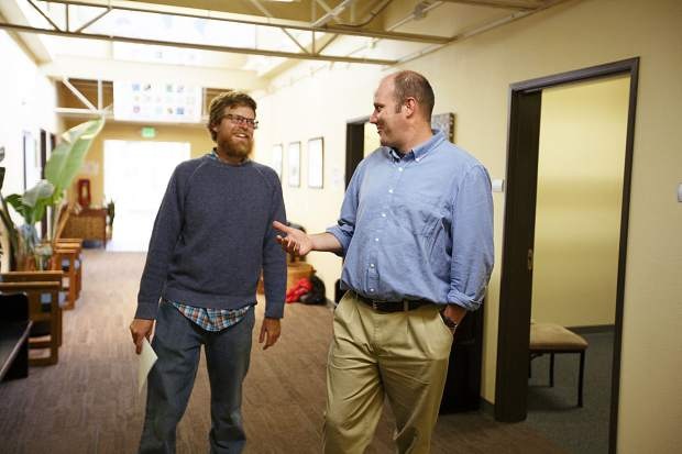 Ben Butler, a part-time math teacher at The Peak School, and head of school Travis Aldrich chat in the hallway Wednesday, Sept. 13, in Frisco.