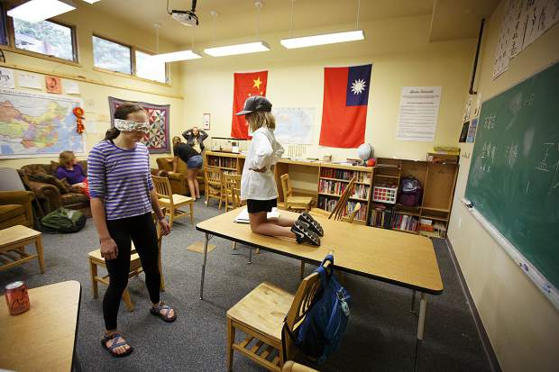 Students at The Peak School in Frisco participate in a blindfold challenge during a class session on Wednesday, Sept. 13, in Frisco.