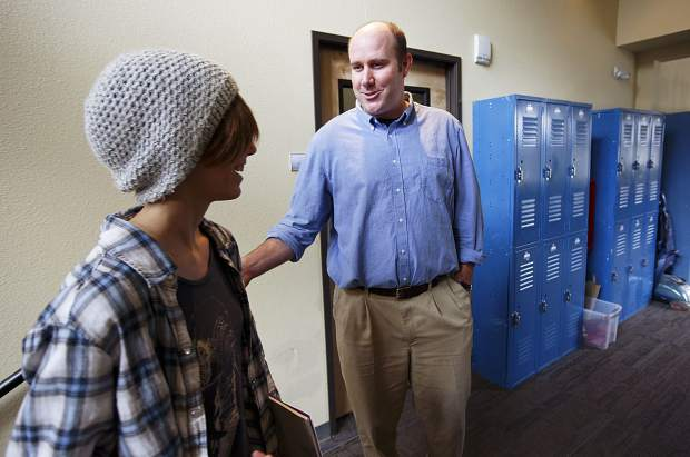 Travis Aldrich, The Peak School's new head of school, offers a greeting on a student's way to class on Wednesday morning, Sept. 13, in Frisco.