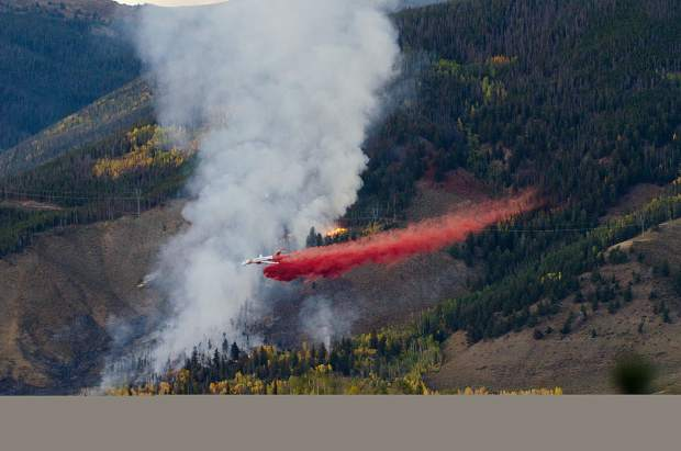 An air tanker dumps slurry onto the Tenderfoot2 Fire Monday evening.
