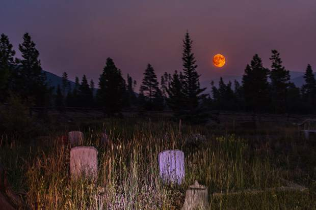 Full moon in smokey air at the Dillon Cemetery on the night of Sept. 5.