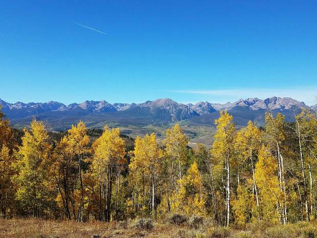 The Gore Range from Ute Pass, featuring a colorful aspen grove.