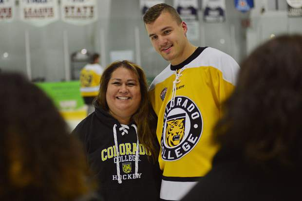 Cecilia Gonzales poses for photos with Colorado College hockey player Nick Olczyk Friday at the Stephen C. West Ice Arena in Breckenridge. Gonzales lives in Colorado Springs and has Tigers season tickets. She was in Breckenridge for a nice break and to see the team face University of Lethbridge, Alberta, Canada, on Saturday night in an exhibition.
