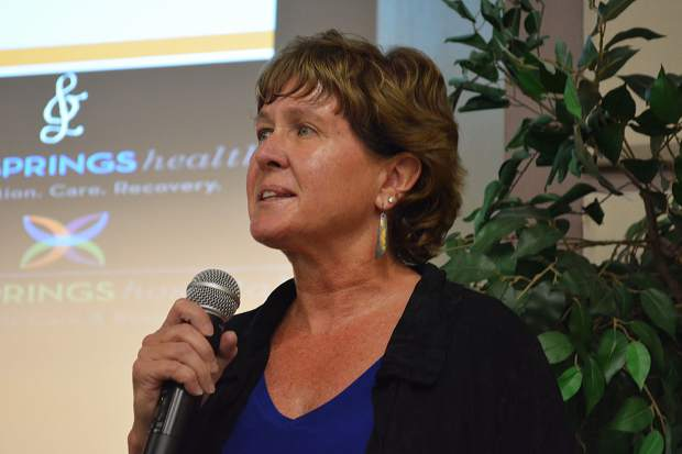 Sharon Raggio, president and CEO of Mind Springs Health and West Springs pyschiatric hospital in Grand Junction, speaks before a panel discussion on suicide prevention in Breckenridge on Saturday, Sept. 23.