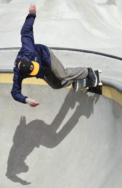 Dewey Cohen grinds the lip of a bowl Wednesday at the skate park in Breckenridge.