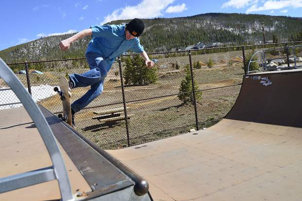 Peter Holton, Vermont, 21, stalls on one of the half-pipe lips Wednesday at the skate park in Frisco.