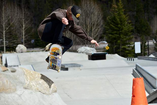 Aaron Golbeck, 23, of Breckenridge lands a jump Wednesday at the skate park in Breckenridge.