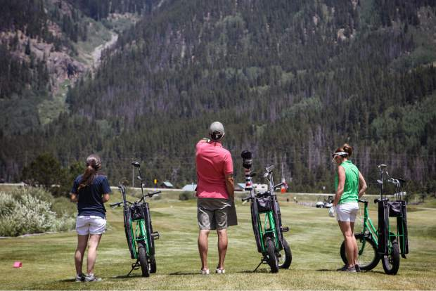 A trio of golfers on the fairway with Copper's newest addition: a fleet of golf bikes. The bikes are a perfect match for the relatively level course and can be taken on fairways when regular carts aren't allowed.