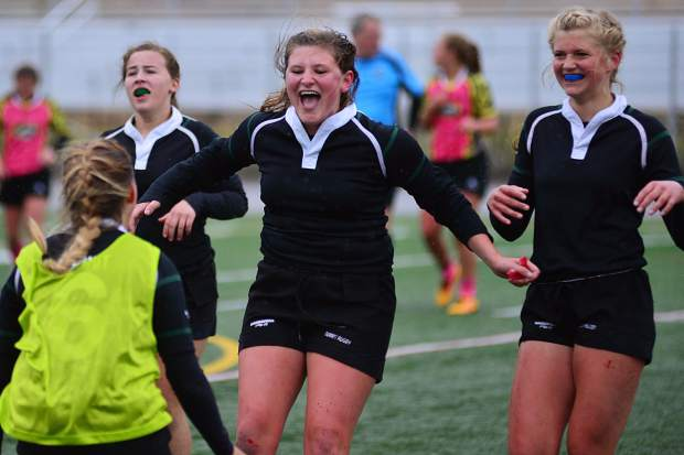 Kassidy Pothier (center) races to celebrate with her teammates after the Summit girls rugby team defeated its in-state rival, the Westside Swarm, 33-5 on Saturday in the championship game of the Tigers' tournament.