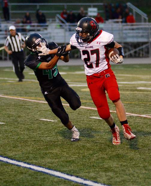 Summit linebacker David Birmingham fights off a stiff-arm as he drags down Steamboat Springs running back Tanner Raper in the second quarter of a nonconference matchup Friday night in Breckenridge. Summit won 24-3.