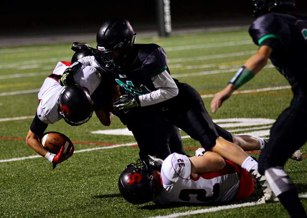 On the return, Summit defenders bring down Steamboat Springs kick returner Canon Reece in the third quarter Friday night in Breckenridge after senior safety Vale Hildebrand had returned an interception for a touchdown on Steamboat's pervious drive.