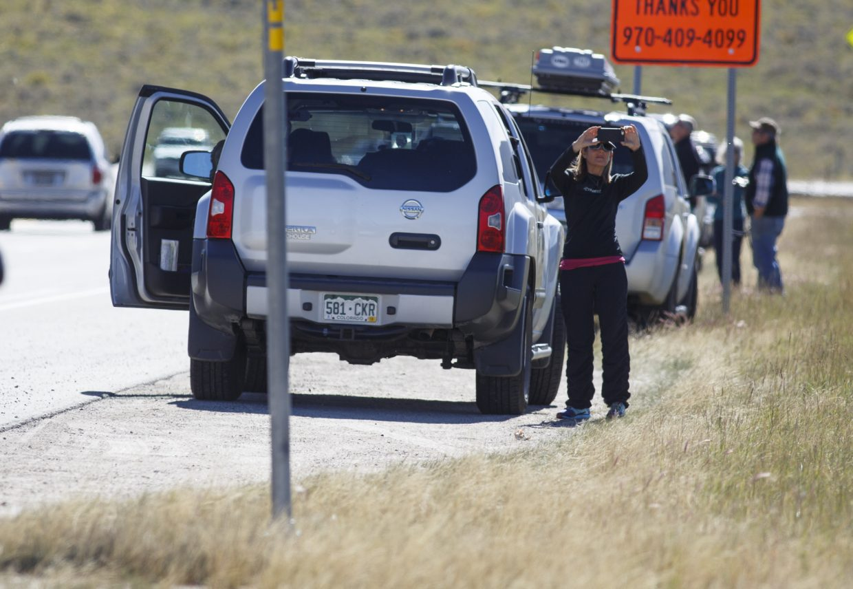 Passing motorists pull over along Highway 6 to take photos of the Tenderfoot2 Fire Tuesday, Sept. 19, in Dillon.