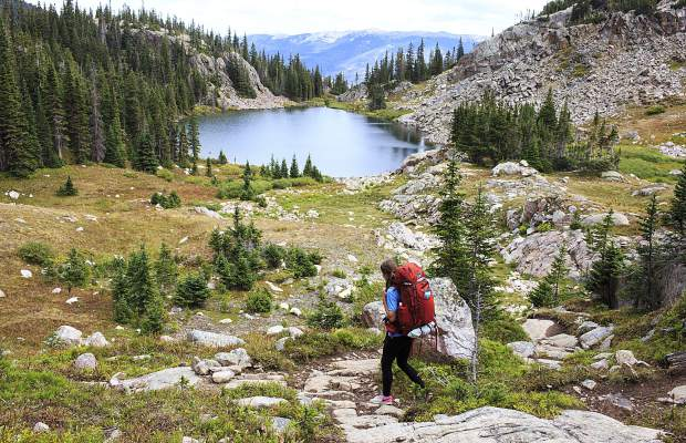 Denver resident Emily Harrell hikes Sunday by lower Willow Lake above the basin where the town of Silverthorne rests.