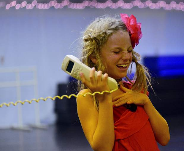Using an old phone as a prop, Indy Tancheff rehearses Saturday at Alpine Dance Academy for a Halloween variety show at 6 p.m. Friday at the Riverwalk Center in Breckenridge.