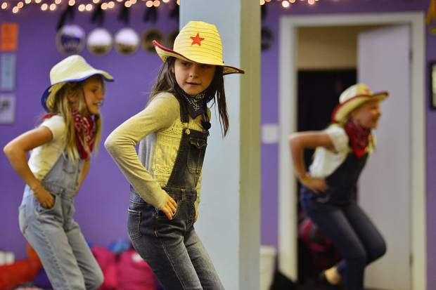 Indy Tancheff, Tessa Ramsay and Sophie Feller practice their country-inspired dance Saturday at Alpine Dance Academy.