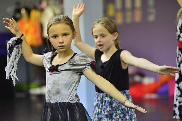 Students at Alpine Dance Academy practice their moves during a dress rehearsal on Saturday for an upcoming Halloween variety show Friday in Breckenridge.
