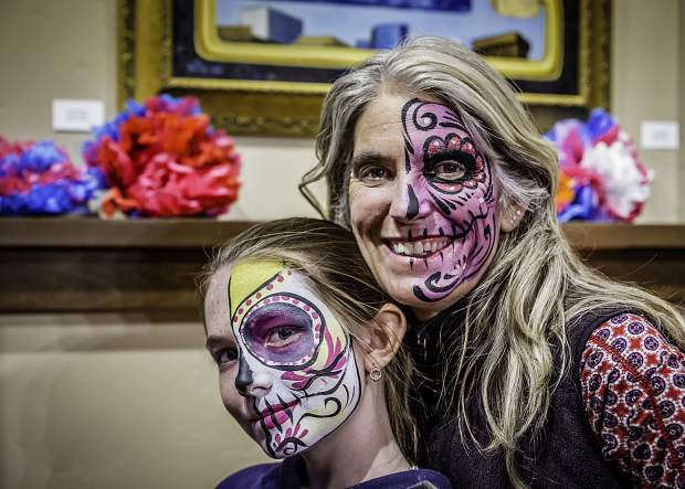 Local mother and daughter duo Maura Murphy and Nieve Nelson with their faces painted to celebrate Dia de los Muertos.