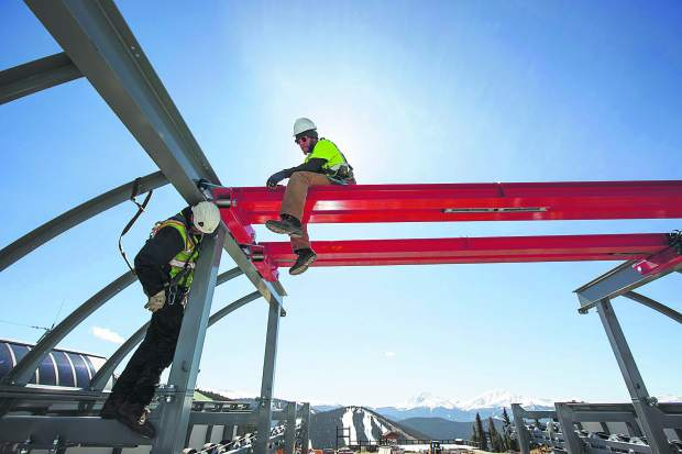 Keystone construction workers Eric Mills, left, and Andrew Lardin at work on the Montezuma Express Lift Friday, Oct. 13, on Dercum Mountain at Keystone Ski Resort.