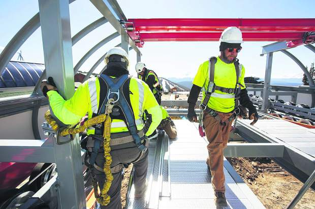 Constructio workers at the top terminal of Montezuma Express Lift Friday, Oct. 13, on Dercum Mountain at Keystone Ski Resort.