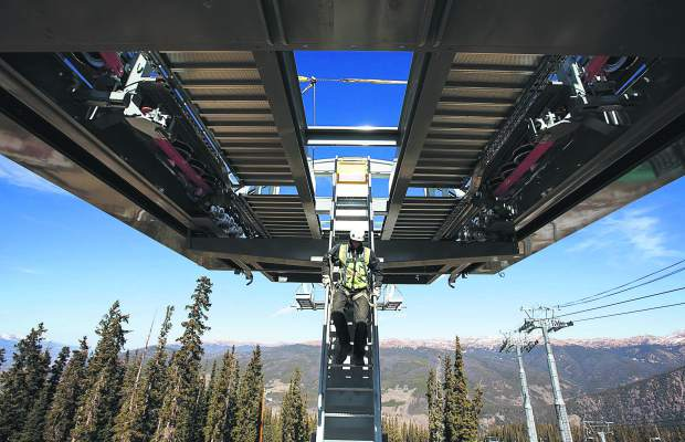 Keystone construction worker Eric Mills descends from the top terminal of Montezuma Express Lift Friday, Oct. 13, on Dercum Mountain at Keystone Ski Resort.