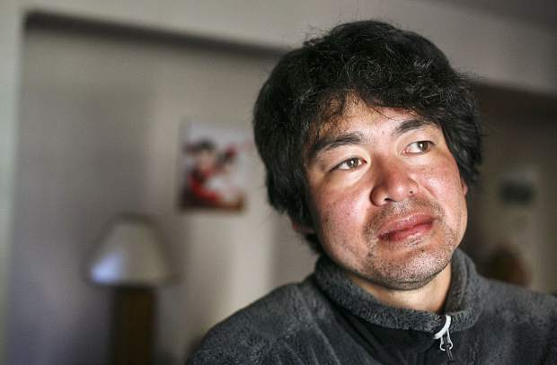 Shuei Kato, looks out the window from his home in Wildnernest near Silverthorne on Wednesday Oct. 11, after surviving three subzero nights in the backcountry after getting lost on his way down from Colorado 14,000-foot peak Missouri Mountain this past Saturday.