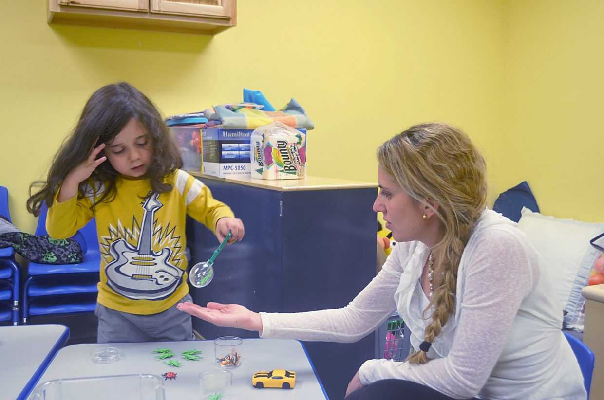 Crowley Pierce, 3, works on his coordination with one of his favorite games for FIRC parent educator Gabriela Castro.
