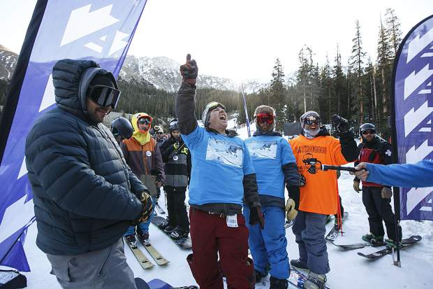 Snowboarders anticipate the first chairlift ride of the 2017/2018 ski and snowboard season Friday, Oct. 13, at Arapahoe Basin Ski Resort.