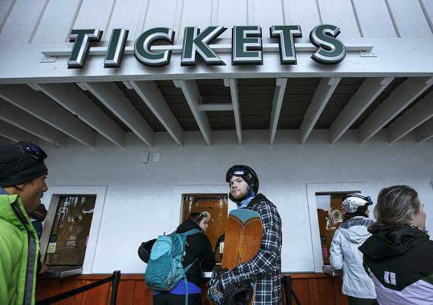 Opening day attendants await for their chairlift passes Friday, Oct. 13, at Arapahoe Basin.