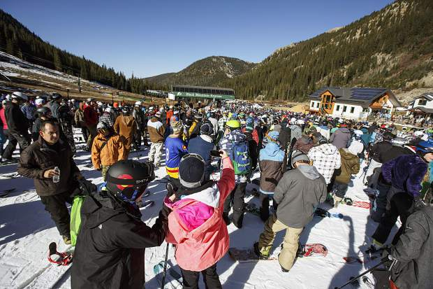 Snowboarders and skiers take part of the opening day of 2017/2018 season Friday, Oct. 13, at Arapahoe Basin.