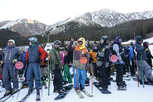 Snowboarders and skier await for their first chairlift ride of the 2017/2018 season Friday, Oct. 13, at Arapahoe Basin Ski Resort.