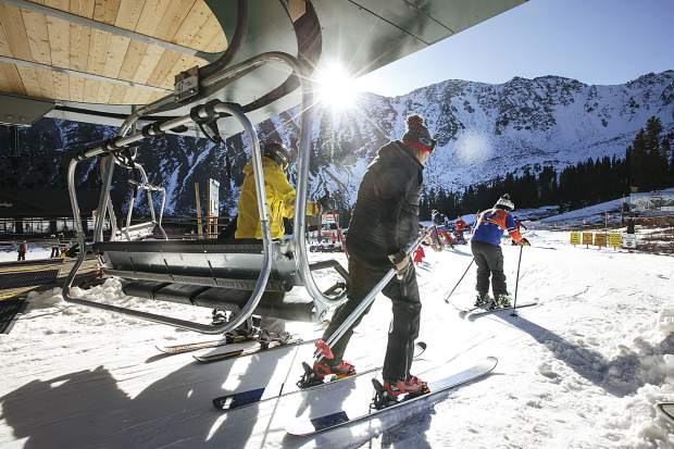 Skiers disembark from the top of Mountain Express Chair Friday, Oct. 13, at Arapahoe Basin.