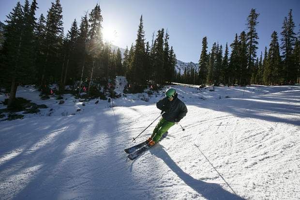 A skier rides down High Noon run Friday, Oct. 13, at Arapahoe Basin.
