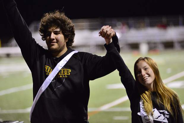Summit Tigers Mario Ramirez and Ashley Edgington react after being named homecomeing king and queen Friday night during a football game at Summit High School.